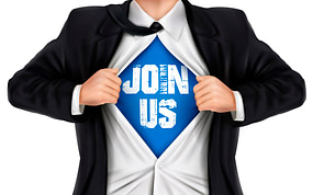 """Man tearing open his suit jacket and shirt, revealing a blue t-shirt with white letters saying, """"Join Us"""""""